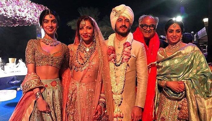 Sridevi and Boney Kapoor and daughter Khushi pose with Mohit Marwah and the bride at their wedding in Dubai