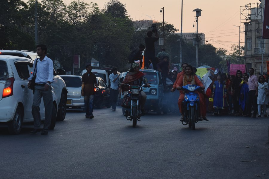 Ladies ride motorcycles in front of the procession during the Aurat March 2018 held at Frere Hall, Karachi, Pakistan, March 8, 2018. Geo.tv/Author