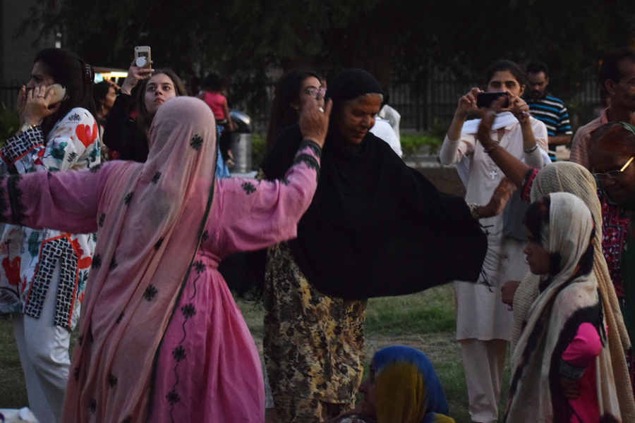 Ladies representing minorities from the interior areas of Pakistan dance at the Aurat March 2018 held at Frere Hall, Karachi, Pakistan, March 8, 2018. Geo.tv/Author