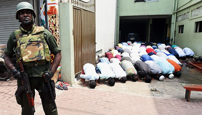 Muslims pray under military protection in Sri Lanka after riots