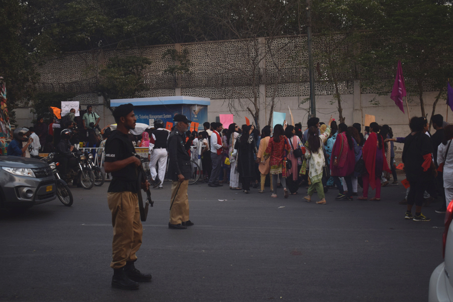 Police officers halt traffic to let the procession pass during the Aurat March 2018 held at Frere Hall, Karachi, Pakistan, March 8, 2018. Geo.tv/Author