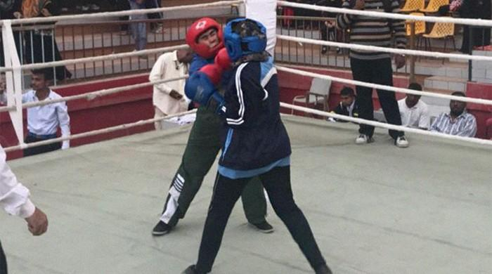 In Karachi's Lyari, women break barriers one punch at a time