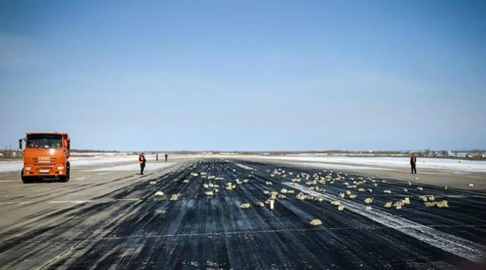 Russian runway paved with gold