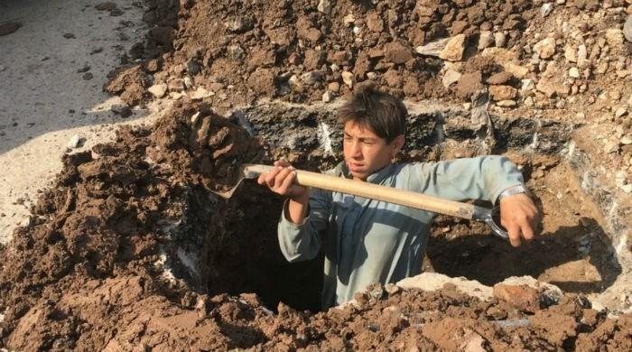 In violation of rules, 14-year-old toils away at Peshawar BRT project