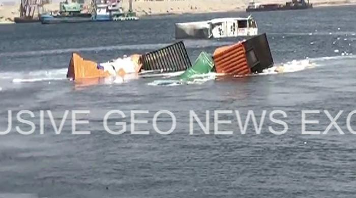 21 containers fall into sea after two ships collide at Karachi port