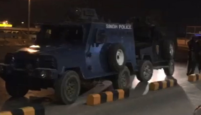 Two armoured personnel carriers parked at the Quaid-e-Azam International Airport to shift Rao Anwar to an unknown location. Photo: Geo News