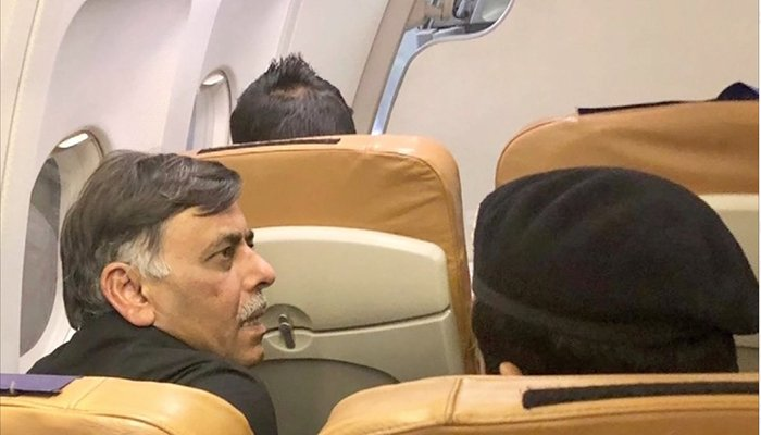 Arrested former SSP Malir pictured in the airplane carrying him to Karachi. Photo: Geo News