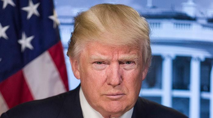 Trump sets China tariff plan, edges away from global trade war