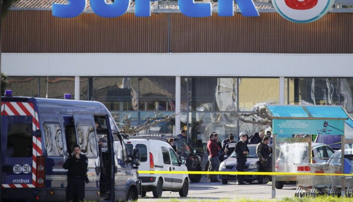 France praises policeman who died after hostage swap during attack on supermarket