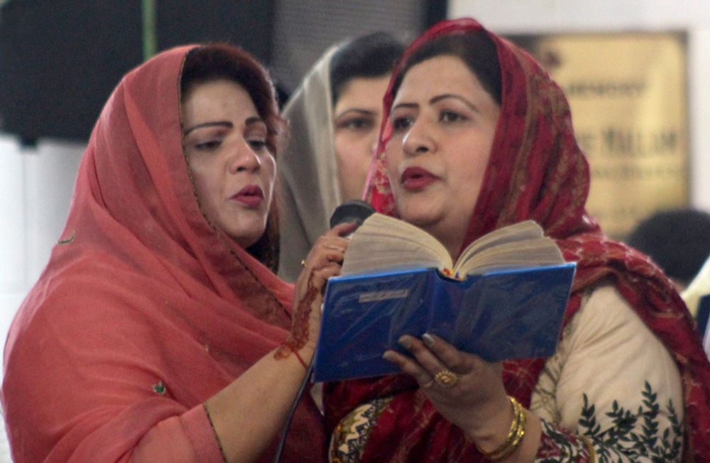 Women from the Christian community recite their holy book during Easter celebrations at a church in Peshawar.—INP photo
