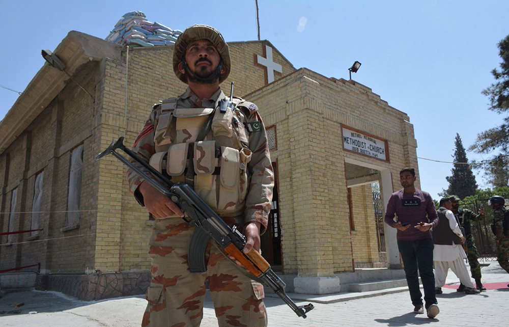 A security personnel stands guard during a Easter mass outside a Church in Quetta on April 1, 2018.—AFP photo