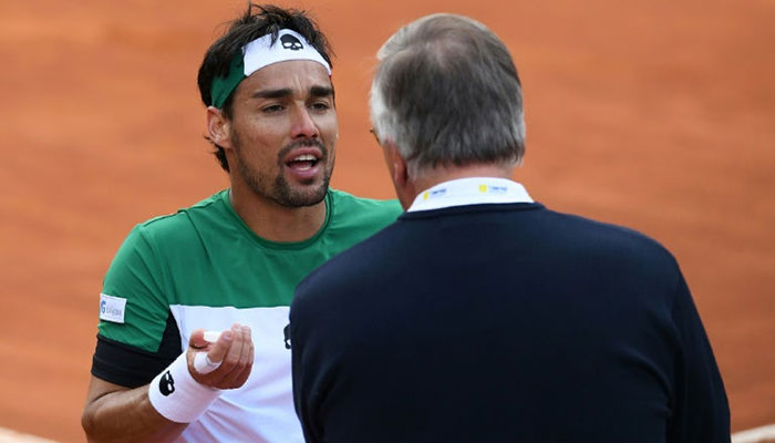 Italy's Fabio Fognini argues with the referee during his Davus Cup clash with France's Jeremy Chardy