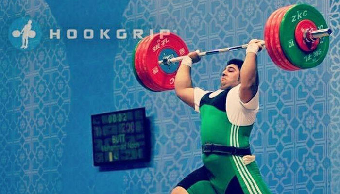 Weightlifter Nooh Dastagir Butt in action  File