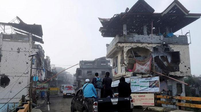 Teary-eyed, hundreds search through rubble in devastated Philippines city