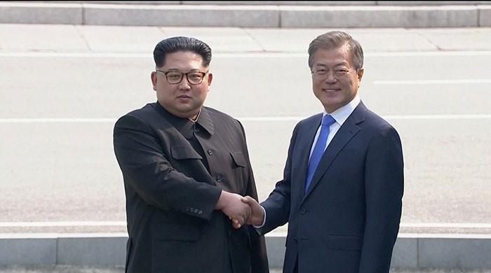 'A new history starts now' as leaders of two Koreas begin summit