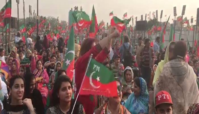 Party workers pictured at the venue of Pakistan Tehreek-e-Insaf's rally in Lahore. Photo: Geo News