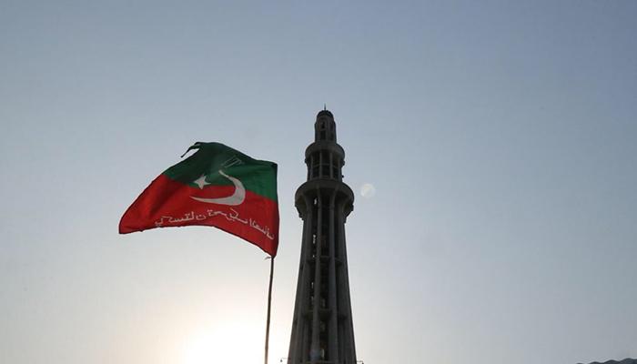A Pakistan Tehreek-e-Insaf flag hoisted near Minar-e-Pakistan in Lahore. Photo: PTI twitter