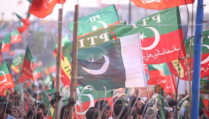 Party workers carrying Pakistan Tehreek-e-Insaf's flags at the rally ground. Photo: PTI twitter