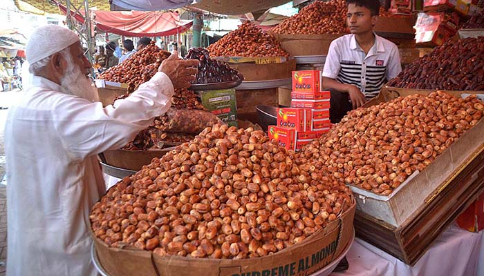 A vendor displaying dates to attract the customers at Tower Market in Hyderabad. Photo: APP