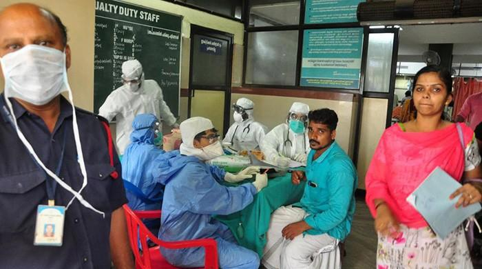 Ten die in India outbreak of brain-damaging virus, spurring rush to hospitals
