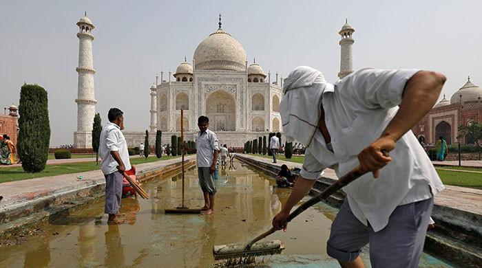 Pollution turns white marble Taj Mahal yellow and green