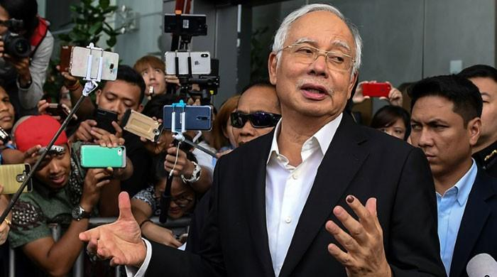 Almost $30 million and 400 handbags seized in corruption raids linked to Malaysia's Najib