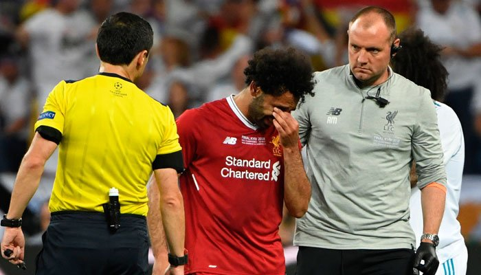 gyptian forward Mohamed Salah reacts after an injury