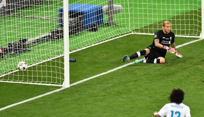 Liverpool´s German goalkeeper Loris Karius sits in front of his goal after a shot by Real Madrid´s Benzema