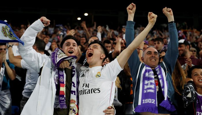 Real Madrid fans celebrate their third goal