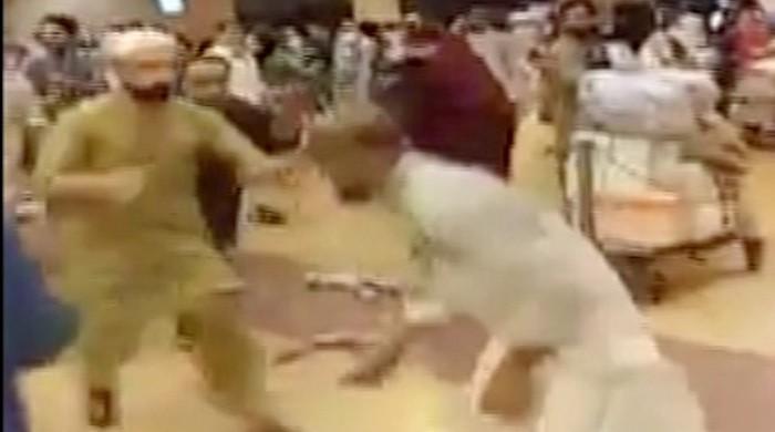 WATCH: Umrah pilgrims brawl at Karachi airport