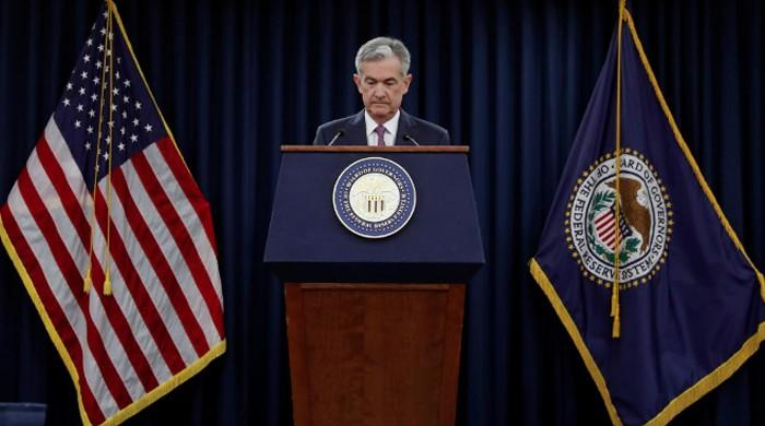US Fed lifts rates, drops crisis-era guidance