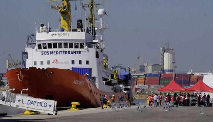 Migrants disembark in Spain after Mediterranean standoff