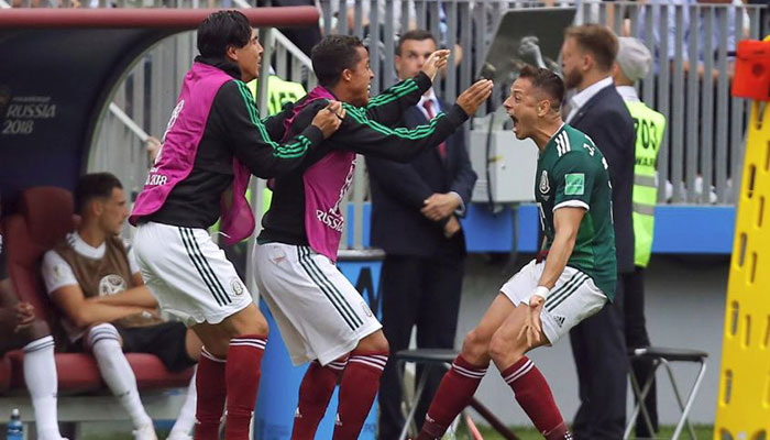 Mexico's Javier Hernandez celebrates their first goal with team mates. Photo: Reuters