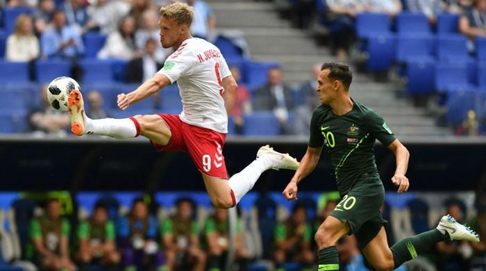 Jedinak penalty helps Australia hold Denmark 1-1