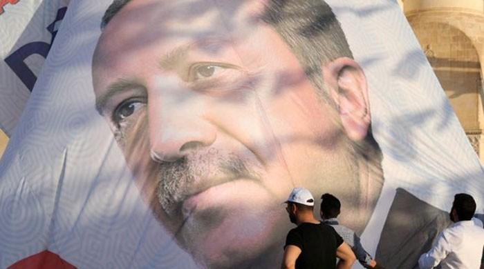 In Turkey's pious heartland, faith in Erdogan trumps economy worries