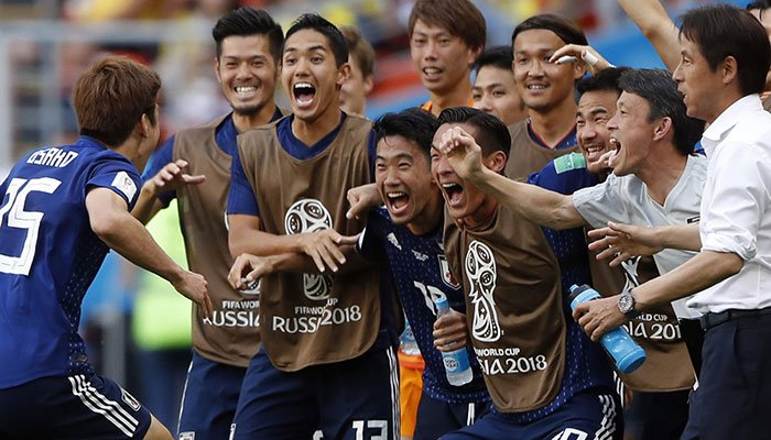 95f93ad0e Yuya Osako of Japan (L) celebrates with teammates after scoring the 2-1  during the FIFA World Cup 2018 group H preliminary round soccer match  between ...