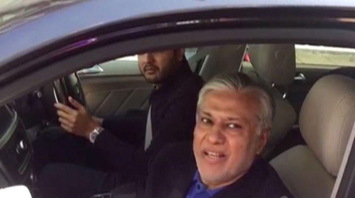 Dar seen avoiding journalists' queries in London