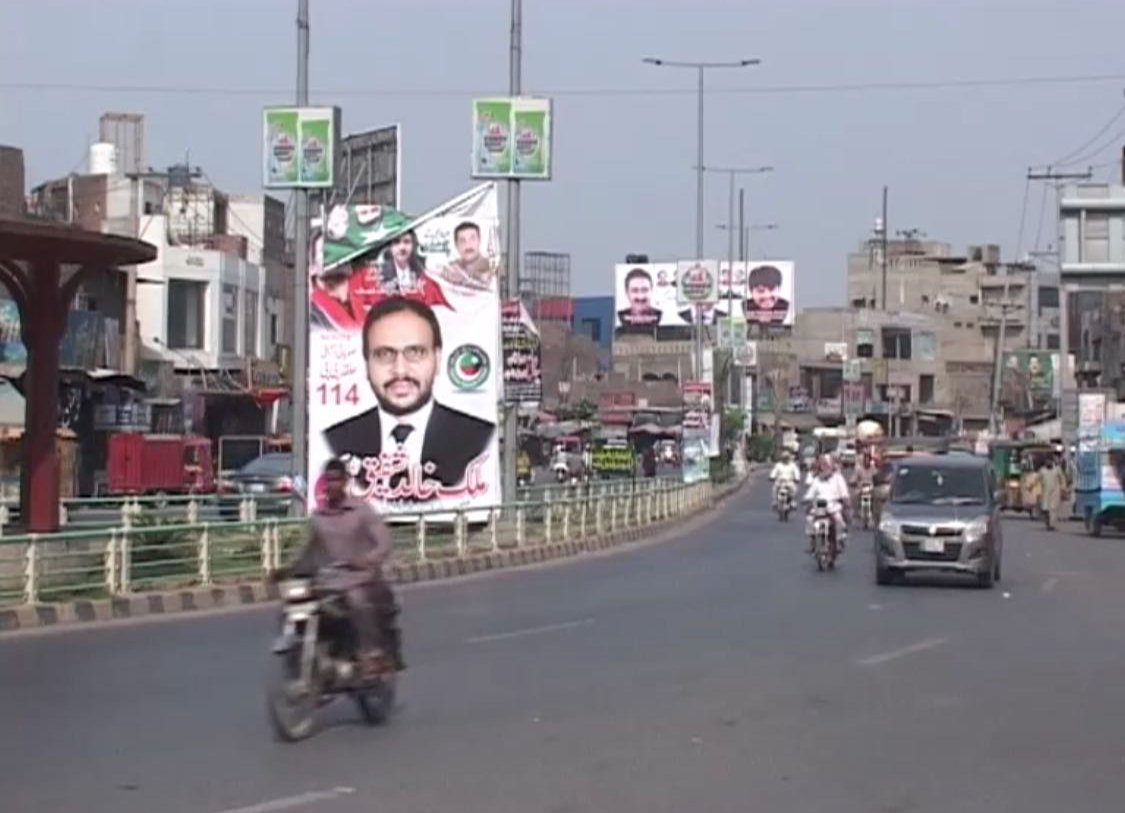 Campaign posters for PTI candidate in Faisalabad