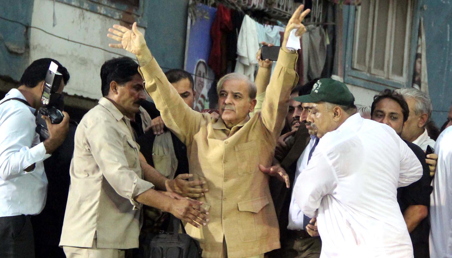 Pakistan Muslim League-Nawaz President Shehbaz Sharif waves to his supporters during the public meeting at Khadda Market Lyari. Photo: Online