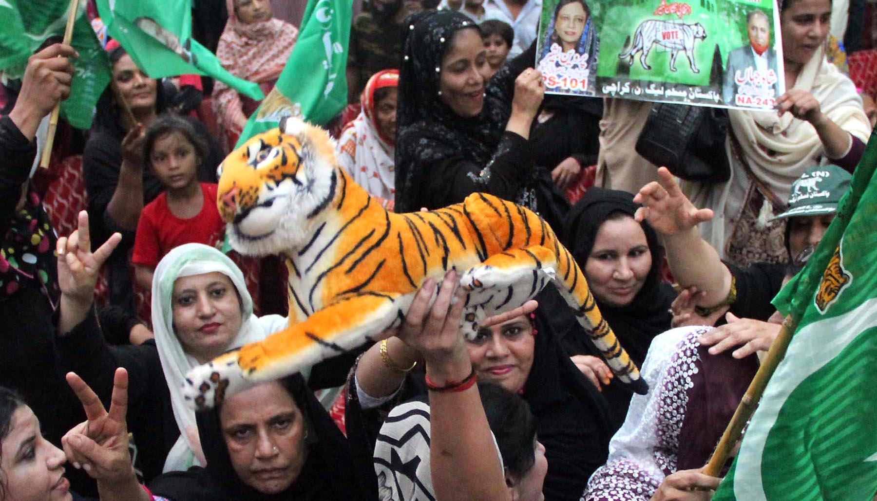 Pakistan Muslim League-Nawaz workers hold party's election symbol 'tiger' during party's president Shehbaz Sharif's public meeting at Khadda Market Lyari. Photo: Online