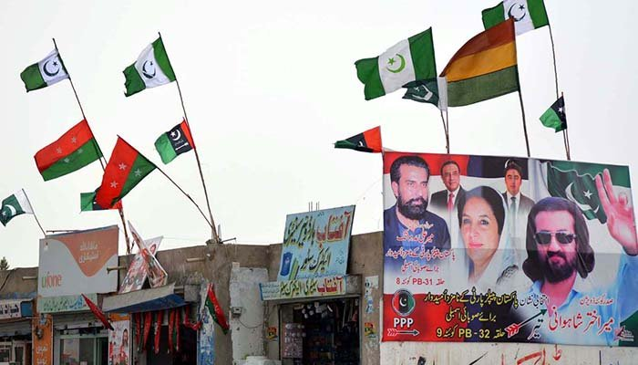 A view of flags of different political parties for the upcoming general election at Saryab Road in Quetta. Photo: INP