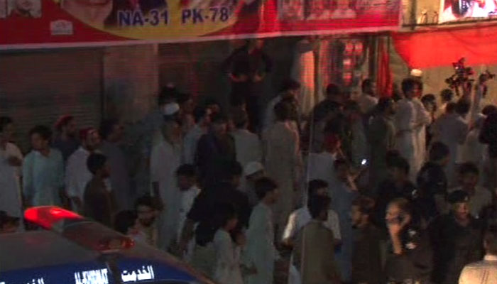 A picture shows people gathered at the corner meeting venue in Yaka Toot where a suicide blast occurred in Peshawar, Pakistan, July 10, 2018. Image: Geo News