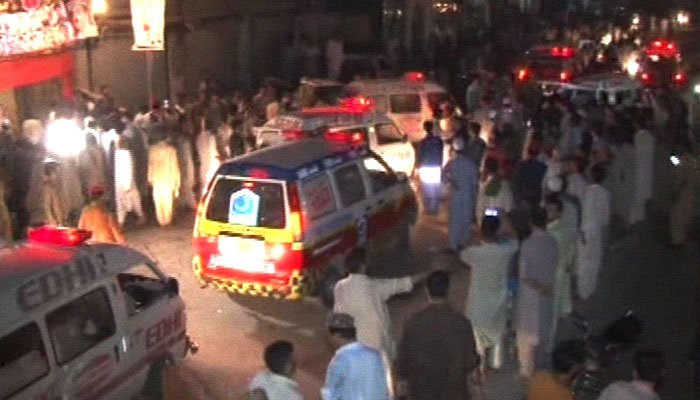 A picture shows ambulances arriving at the scene as people gather at the corner meeting venue in Yaka Toot where a suicide blast occurred in Peshawar, Pakistan, July 10, 2018. Image: Geo News
