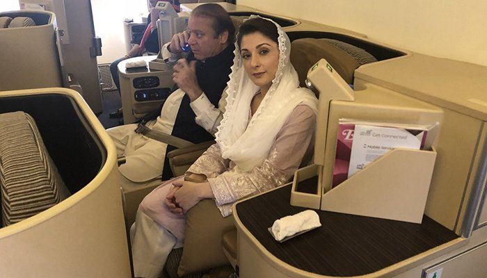 Former Pakistani Prime Minister Nawaz Sharif and his daughter Maryam sit on a Lahore-bound flight due for departure, at Abu Dhabi International Airport, UAE July 13, 2018. Photo: Social media