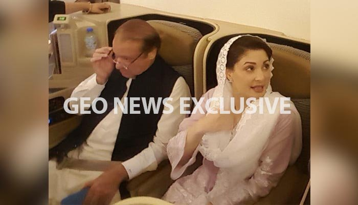 Nawaz Sharif and Maryam Nawaz on the flight headed from Abu Dhabi to Lahore. Photo: Geo News