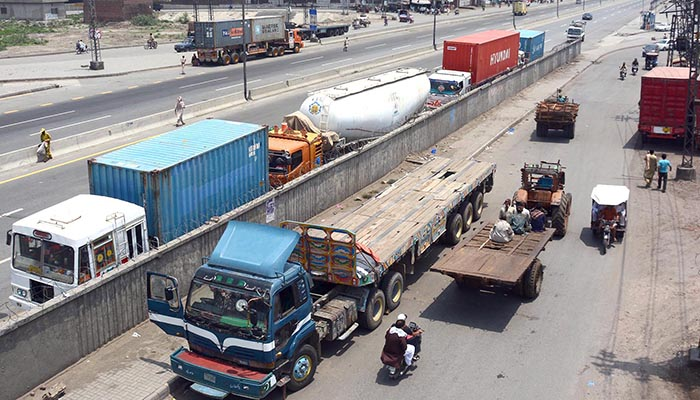 Containers parked at Ring Road in Lahore. Photo: Online