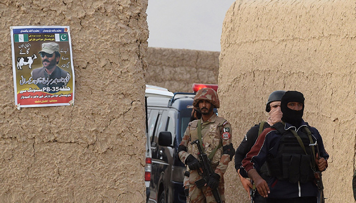 Frontier Constabulary (FC) personnel gather in Mastung on July 13, 2018, following a bomb blast here at an election rally. Photo: AFP