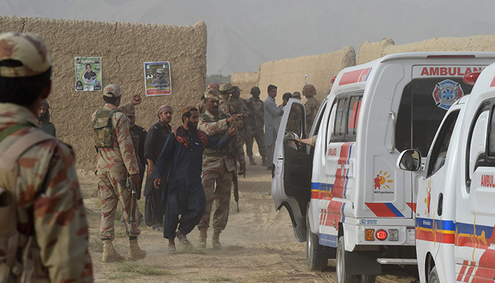 FC personnel gather in Mastung on July 13, 2018, following a bomb blast here at an election rally. Photo: AFP