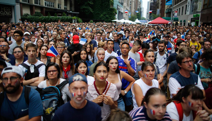 People watch the World Cup final soccer match between France against Croatia on July 15, 2018 in New York. Photo: AFP