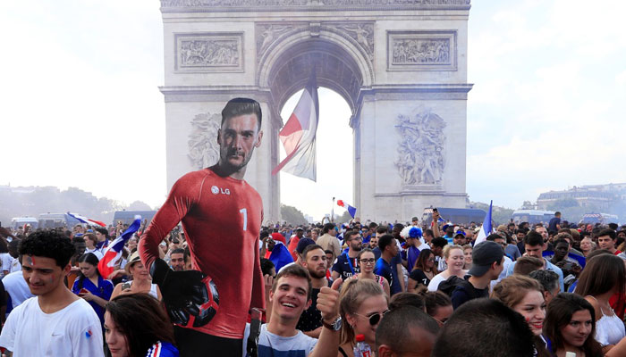 France fans react on the Champs-Elysees avenue after they defeated Croatia during their Soccer World Cup final match. REUTERS